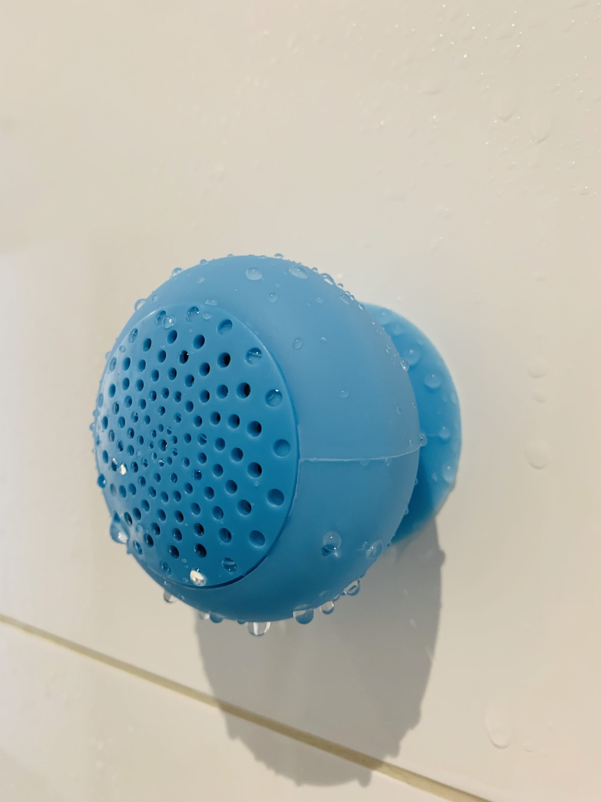 Water resistant wireless Bluetooth speaker in a showeroom picture